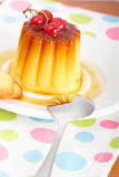Cream caramel dessert with red currants Stock Photos