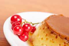 Cream caramel dessert with red currants Royalty Free Stock Photo
