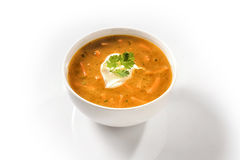 Cream Carrot Soup Garnished with Sour Cream. Cream Carrot Soup in a White Cup Garnished with Sour Cream royalty free stock photos