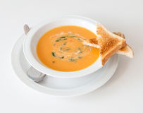 Carrot soup. Cream carrot soup with toast bread stock images