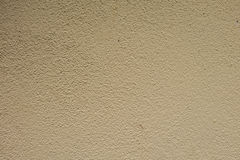 Cream cement wall texture background. Royalty Free Stock Photo