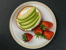 Cream Cheese and Avocado Bagel Stock Images