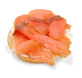Cream Cheese Bagel and Smoked Salmon. Bagel and Cream cheese topped with smoked salmon isolated on a white background Royalty Free Stock Photos