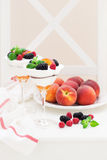 Cream cheese, biscuits, peaches and fresh berries dessert. Selective focus Royalty Free Stock Photo