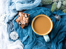 Cream cheese brownies and coffee with milk. Cream cheese brownies with cookies on blue and mug of coffee and milk. Winter treat square chocolate bars. Holiday stock photos