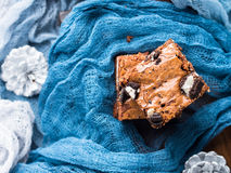 Cream cheese brownies with cookies on blue Stock Photos