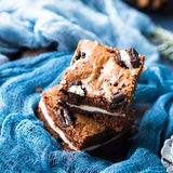 Cream cheese brownies with cookies on blue Royalty Free Stock Images