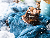 Cream cheese brownies with falling snow effect Royalty Free Stock Photo