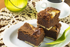 Cream cheese brownies on a white plate Stock Images