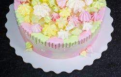 Cream cheese cake with chocolate twist and bright merengue decor Stock Photos