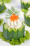 Cream cheese with caviar on cucumber stock photos
