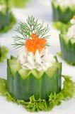 Cream cheese with caviar on cucumber Stock Photos