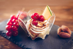 Cream cheese dessert with currant and melon Stock Image