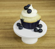 Cream Cheese Frosted Blueberry Muffin stock photos