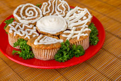 Cream cheese frosted carrot cake cupcakes. Stock Photography