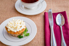 Cream cheese frosted carrot cake cupcakes. Stock Photo