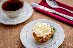 Cream cheese frosted carrot cake cupcakes. Stock Image