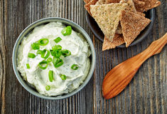 Cream cheese with green onions and herbs Stock Images
