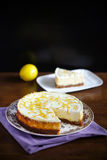 Cream cheese lemon cheesecake with crumble and zest Stock Images