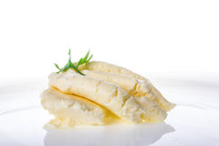 Cream cheese milk product. Portion on white plate with parsley on top; soft cheese cream stock photos