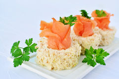 Cream cheese roll canapes with smoked salmon Stock Photo