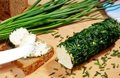 Cream cheese, rolled in chive. Cream cheese rolled in chive , bread slice and chive royalty free stock photo
