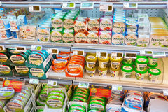 Cream cheese in a store. WALLONIA, BELGIUM - MAY 2016: Chilled shelves filled with assortment of soft cheeses in a Carrefour supermarket. Boursin is a brand of royalty free stock photo