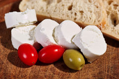 Cream cheese with tomatoes Stock Photos