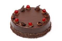 Cream chocolate cake with cherries on white background Royalty Free Stock Photos