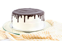 Cream and chocolate cake. Isolated on white Stock Photography