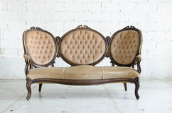 Cream classical style couch in vintage room Royalty Free Stock Photo