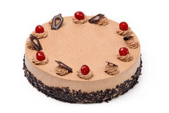 Cream cocoa cake with cherries on white background Royalty Free Stock Images