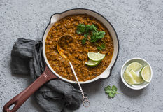 Cream coconut lentil curry in a cast iron skillet, top view. Healthy vegetarian food Stock Photography