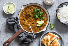 Cream coconut lentil curry, rice, naan bread - vegetarian lunch buffet. Top view. Flat lay Royalty Free Stock Photography