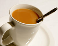 Cream in Coffee Stock Photography