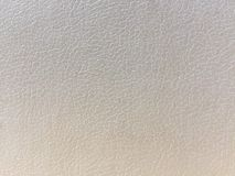 Cream color background-structure of artificial leather stock photos
