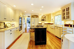 Cream color kitchen with large white sink and classic design. Cream large bright color kitchen with large white sink and classic design stock photos