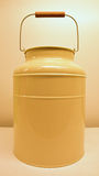 Cream Color Milk Can. Rusty Design. Beautiful handle with sturdy yet flexible wire and natural wood stock photos