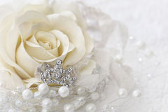 Cream color rose with jeweled crown Royalty Free Stock Photo