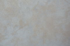 Cream color tile background Stock Images