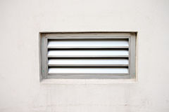 Cream color wall and door Ventilator. Royalty Free Stock Image
