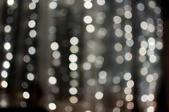Cream-colored bokeh balls, blurred garland, texture, background, photography is out of focus, copy space, abstract royalty free stock images