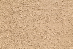 Cream Colored Bumpy Background. Closeup to a cream colored bumpy background royalty free stock photos