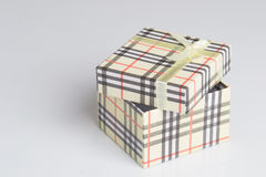 Cream colored gift box. Cream gift box with colorful diagonal stripes royalty free stock images