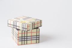 Cream colored gift box. Cream gift box with colorful diagonal stripes Stock Image