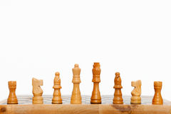 Cream colored wooden chess pieces Royalty Free Stock Image