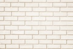 Cream colors and white brick wall art concrete or stone texture background. In wallpaper limestone abstract paint to flooring and homework/Brickwork or stock photography