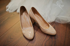 Cream colour wedding  shoes Stock Photography
