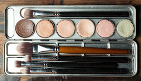 Cream concealer palette in metal case. Royalty Free Stock Photography