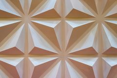 Cream Concrete Wall with a Pattern of Convex Triangles. Cream Concrete Wall with a Pattern of Convex Squares and Triangles stock photo